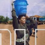 E! NEWS: Rihanna pictured carrying a bucket of water on her head