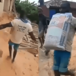 Nigerian Labourer Wins N100K Bet After Lifting A 50kg Bag Of Cement To The Roof Of A Storey Building